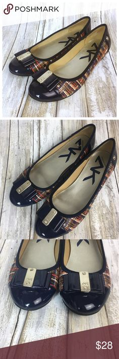"""Anne Klein Sport Flat Anne Klein Sport Abandoned Ballet Flat. Glossy embossed embossed fabric upper with patent accents. Navy patent toe detail with plaid print. Metallic decorative buckle Round patent cap toe Flexible synthetic sole Size 6.5 Slight heel at 1/2"""" Preowned.  Bundle in my closet and save. I ship same day or next day almost always! Trustworthy seller! #010905 Anne Klein Sport Shoes Flats & Loafers"""
