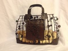 The Handbag Cork Cage with entwined colored glass spheres is a fun way to keep and display your wine corks. http://www.WineYesPlease.com