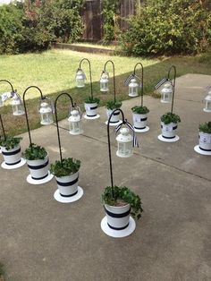 Jen, this idea of the hooks in the buckets for aisle decoration could work well for us since the ceremony is now on a paver surface.