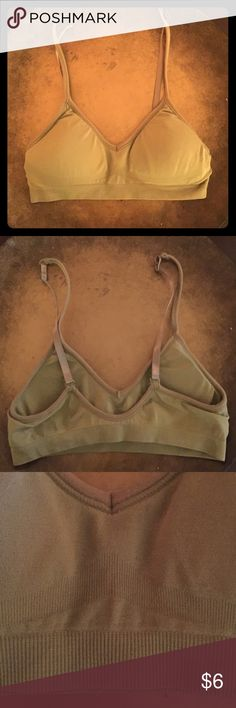 Olive Green Sports Bra Sports bra with inner padding and no wiring. Great for wearing under backless tops/dresses or any top! 88% Nylon and 12% Spandex. Is more like a size small instead of one size. Intimates & Sleepwear Bras