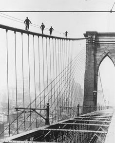 1926: Four men who wish to be hired to paint the Brooklyn Bridge balance on its beams as a test to see if they can handle the heights.