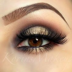 beautiful smokey eyes with a twist, the dark inner corners and highlighted mid-lid gives the illusion of bigger brighter eyes, mascara and false lashes, golden pigments used on black base to enhance the look