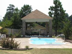 Parrot Bay Pools and Spas Outdoor Living Fiberglass Swimming Pool Brick Outdoor Seating/Grilling Area Fayetteville, NC