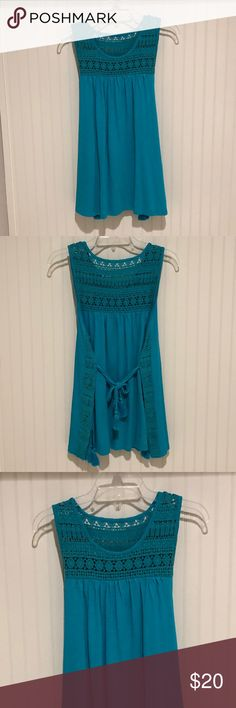Turquoise Crochet Tunic NWT! Sleeveless turquoise tunic with crochet detail and     multiple ties in the back. Made of 60/40 Cotton/Modal. Crochet lace detail is 100% Cotton. crown & ivy Tops Tunics
