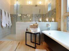 Arrangement of tub under window, plus shower behind.