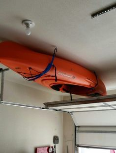Quick and easy kayak storage. 4 eyelets and two pull straps. Mounts to the ceiling with the four eyelets (make sure there are in the rafters of the ceiling). Hook straps in to the eyelets. Then put the kayak in the straps and pull on the straps. Diy Kayak Storage, Boat Storage, Storage Racks, Ceiling Hooks, Ceiling Storage, Basement Storage, Shed Organization, Organizing, Kayak Camping