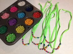 Shoestring necklaces with beads representing the colors on the Girl Scout Law daisy 10/25/2012