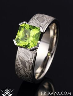 This unique engagement ring features our White Mokume Gane Band with a vibrant green designer cut peridot! Customize your Mokume Princess Solitaire Engagement Ring in the mokume, metal and center stone you love....