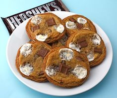 """S'More Cookies - They start out as a basic chocolate chip cookie with graham cracker crumbs stirred in. Then you add in mini marshmallows and Hershey chocolate bars. They really taste like a Smore's! Make a big batch because everyone will want """"SMORE"""" of these cookies:)"""