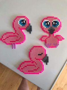Pink flamingos made from perler beads. Flamingo perle hama Pink flamingos made from perler beads. Perler Bead Designs, Easy Perler Bead Patterns, Melty Bead Patterns, Perler Bead Templates, Hama Beads Design, Diy Perler Beads, Perler Bead Art, Loom Patterns, Knitting Patterns