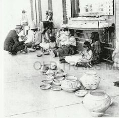 Native American artisans selling wares in front of the Winslow Harvey House, 1908 :: Harvey Girls of the Winslow Harvey Houses