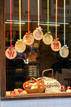 Cute Window Display - could do it at home with dollar store plates and colored sharpies for the breakfast nook against the wall