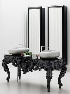 """""""The washbasins are from the Soap Bath Series and are sleek and modern with a smooth curved form resembling a symmetrical pebble or bar of soap."""""""