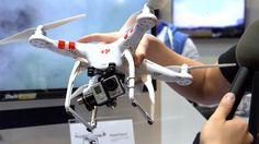 After you get enough practice flying a mini-quad the next step is something like DJI's Phantom 2 mid-size quadcopter. We go hands-on with this quadcopter at . Dji Phantom 2, Military Aircraft, Quad, Hands, Drones, Youtube, Gadgets, Technology, Awesome