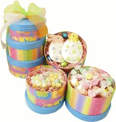 Easter Medley Candy Tower  Item # easter-medley-candy-tower  Easter candies fill our joyful spring tower to make the perfect Easter gift!  Includes:  1 Easter Bunny Sugar Cookie, 1 Hatched Chick Sugar Cookie, 6 Chocolate Easter eggs, 30 individually wrapped Easter Bunny Kisses Salt Water Taffy and 8 ounces of Pastel Jelly Beans.    Your Price: $21.95