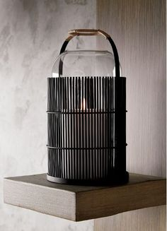 Lanterns light practically every doorway, garden, street, table top and hallway in Japan. Ours takes an unexpected turn in black iron courtesy of the modern/minimalist sensibilities of designer Ross Cassidy.
