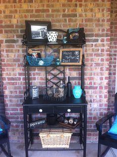 Back porch baker's rack Bakers Rack Decorating, Deck Decorating, Decorating Small Spaces, Outdoor Bakers Rack, Outdoor Shelves, Pond Lights, Modern Cottage, Sunroom Ideas, Porch Ideas