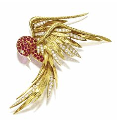 Ruby & Diamond Bird Brooch, Cartier.  Set in 18K yellow gold.  Made in France circa 1950, sold by Sotheby's NYC, December 2009.