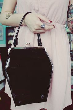 Store all of your everyday essentials in style while also adding to your impeccable vintage look with this black To-Die-For Purse from Unique Vintage! This self-standing purse features a hexagonal, retro-inspired shape made of black patent leather with a Dark Fashion, Gothic Fashion, Fashion Beauty, Vintage Fashion, We Wear, How To Wear, Black Sparkle, Eclectic Style, Pretty Outfits