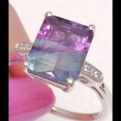 Bi-color Fluorite, White Zircon Ring Bi-color Fluorite, White Zircon Ring features a Octogon 6.15 Ct gem accented with the oldest gem in the world, beautiful White Zircon. Ring is in Platinum Overlay .925 Sterling Silver Nickel Free (Size 8.0) TGW 6.190 CTs. Color Change Fluorite displays blue, turquoise or blue-lavender, transitioning to intense blue or blue-green and has been called one of the most colorful minerals in the world. Many countries produce Florite but the best blue variety is…