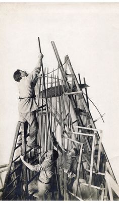 "Tatlin and his assistants Joseph Meyerson and Tevel Shapiro working on the model for the ""Monument to the Third International"" Petrograd, 19..."