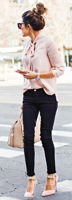I love the contrast between the soft blush pink blouse and the edgy black skinny jeans. And, those shoes are everything.