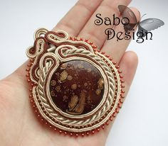 JUPITER - soutache pendant, handmade, embroidered in ecru, beige and brown satin strips, toho beads. Perfect gift - oaak..via Etsy.