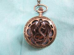 antique pocket watch necklace with bronze lotr by threedollarshop, $4.00