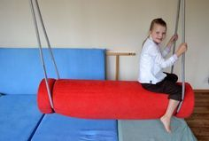 DIY bolster swing to provide vestibular stimulation