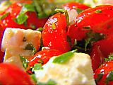 Ina's tomato and feta salad. I make this into a pasta salad adding diced cucumber/red bell peppers and pasta of your choice. I will also add up to 1/2 cup of tzatziki to make it creamy. Is it summer yet?
