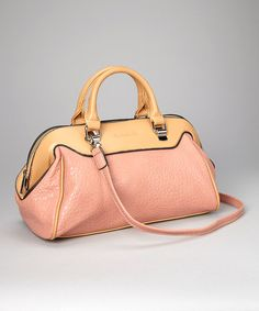 Trendsetting in two complementary hues, this faux leather satchel is classic yet cutting edge. A zip-closed pocket details the exterior, while the zippered interior boasts a single zip compartment. Opt for the detachable strap for hands-free traveling.13.25'' W x 9'' H x 7.5'' DShell: PVCLining: cotton