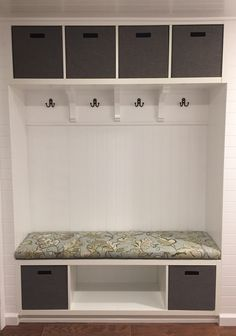 Our IKEA hack mudroom bench. We used two Kallax shelves, paneling and Ballard Designs Felicity fabric for the cushion. #ikeahack #ballarddesigns #mudroom