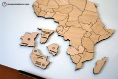 DESCRIPTION Make learning the geography of Africa engaging and beautiful for all ages with this one-of-a-kind magnetic map puzzle. Laser cut then hand built, its creation draws upon the power of digital fabrication and the timelessness of hand craftsmanship. These map puzzles are as irresistible to play with as they are informative. People almost cant help assemble them, finding new relationships between land areas and a better understanding how our world fits together. Inset into each…
