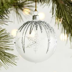 Handblown and hand-painted in the Czech Republic, our snowflake ornament shimmers with silvery glitter. A Pier 1 exclusive. Handblown and hand-painted in the Czech Republic, our snowflake ornament shimmers with silvery glitter. A Pier 1 exclusive. Clear Ornaments, Painted Christmas Ornaments, Christmas Gift Decorations, Xmas Crafts, Diy Christmas Ornaments, Christmas Projects, Navidad Diy, Christmas Makes, Diy Weihnachten