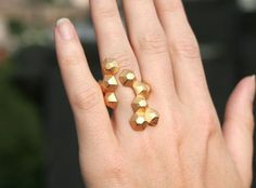 Substantial but delicate at the same time: yellow gold modern geometric 3D printed ring.