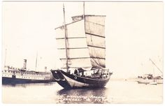 "Chinese Junk ""Amoy"" arriving; having crossed Pacific Ocean, Shanghai to Victoria, B.C. in 87 Days. C.P.R. SS Charmer docked at left."