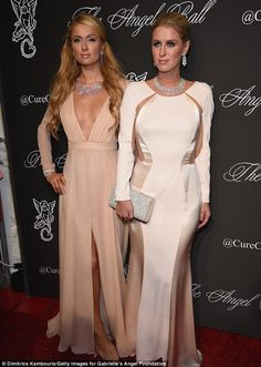 Sibling love:Paris and Nicky Hilton both donned Avakian jewels for their sisters' night out, and the 33-year-old DJ wore a plunging Gabriela Cadena gown