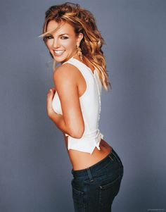 Britney at a photo shoot in 2003....ooh to have her body! She had THE best body, curves, not too skinny, and fit looking!!