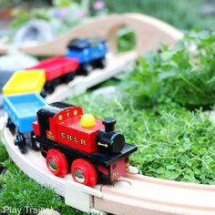 Super easy way to make a DIY outdoor train table...no tools required to make this mini garden railway for wooden trains!