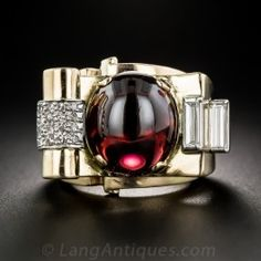 An uber cool and striking Retro ring, circa 1940s, magnificently sculpted in 14 karat yellow gold around a deeply saturated cabochon garnet - an atypical gemstone for the period. The bold and brassy ring shimmers on one side with a pair of sizable, elongated straight baguette diamonds, and on the other with a crashing wave of sparkling single-cut diamonds. This wild and wonderful work of wearable art is a barely sizable size 4 3/4, and measures an ample 1 inch by 5/8 inch.