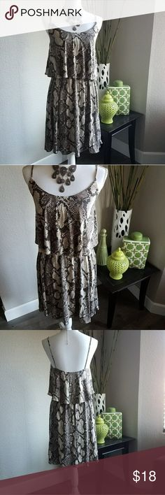 Snake print dress New with tags.  Super cute snake print dress with spaghetti straps.  Perfect for summer! H&M Dresses