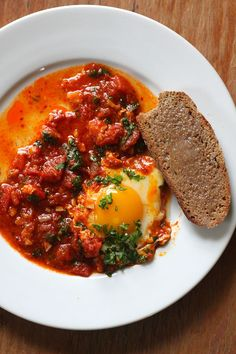Shakshouka is a traditional Tunisian dish that is popular all over North Africa. The eggs are poached in a spicy tomato sauce. You'll want extra bread to mop up the sauce!