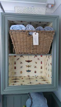 Bathroom storage-repurposed kitchen cabinet.