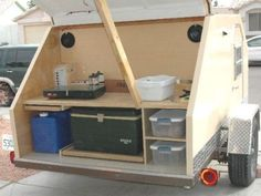 Angular teardrop camper includes an improvised galley