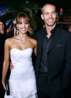 Pin for Later: Paul Walker's Memorable Hollywood Moments  Paul Walker and Jessica Alba smiled for photos together at the LA premiere of their film Into the Blue in September 2005.