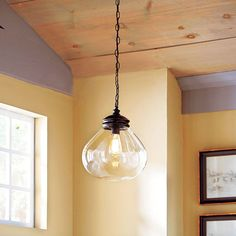 Retro Pendant  With its bulbous glass shade and atmospheric Edison-style bulb, this Past is Present pendant (#198671) has the graceful look of pricey reproductions. Hang one over the sink or three in a row over the island.    About $119; lowes.com