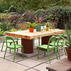 The once cold and cramped space is now a 14x16-foot patio with room for a table for 10. But no space is complete without some personal touches. DIY Tip: Change things up to make your space more interesting. Using wood, concrete, and plastic materials includes contrasting textures that give the patio space depth. The almost neon pops of color from the chairs stand out against the yard's natural shades.