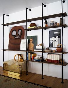Neat wall shelving mounted on what appears to be plumbers piping. Via Mid-Century Modern Freak.