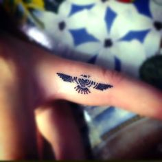 Small Thunderbird on Finger Tattoo Idea
