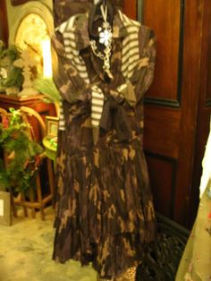 I LOVE this dress. And so does my closet.  Military is IN! This Uncle Frank Button Up Camo Dress is great for any season